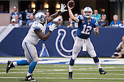 September 11, 2016: Indianapolis Colts quarterback Andrew Luck (12) scrambles and passes over Detroit Lions defensive tackle A'Shawn Robinson (91) during the week 1 NFL game between the Detroit Lions and Indianapolis Colts at Lucas Oil Stadium in Indianapolis, IN.  (Photo by Zach Bolinger/Icon Sportswire)