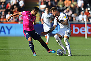 Joe Rodden (22) of Swansea City is challenged by Massimo Luongo (21) of Queens Park Rangers during the EFL Sky Bet Championship match between Swansea City and Queens Park Rangers at the Liberty Stadium, Swansea, Wales on 29 September 2018.