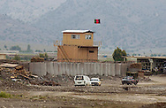 Vehicles make their way past a checkpoint near the Salerno base near the the town of Yakubi in the district of Khost, Afghanistan where deceased farmer Diliwar lived May 2, 2005.  The 22-year-old farmer and part-time taxi driver died in December 2002 while being held in the main United States air base at Bagram, north of Kabul. His death was ruled a homicide by the Army medical examiner.<br />