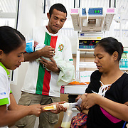 Health worker Santina pump out milk from Laura, not to feed her new born baby but to relieve the pressure. Laura and her husband Muncia had a baby 6 days earlier but are unwilling to breast feed the baby because they have lost two babies in the past and they blame the breast milk. Doctors at the hospital finally established that there is nothing wrong her milk but they still opted for powder milk, a very difficult decision and not recommended by Alola or the hospital. Infant mortality rates are very high in Timor-Leste and one of the reasons for that is poor nutrition. Alola advocate breast feeding till at least two years old and teach women about nutritious supplements such as boiled and mashed rice w vegetables and eggs.  Fundasaun Alola is a not for profit non government organization operating in Timor-Leste to improve the lives of women and children. Founded in 2001 by the then First Lady, Ms Kirsty Sword Gusmao, the organization seeks to nurture women leaders and advocate for the rights of women.