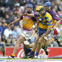 24 July 2005; Tony Griffin, Clare, in action against David O'Connor and Diarmuid Lyng, Wexford. Guinness All-Ireland Senior Hurling Championship Quarter-Final, Wexford v Clare, Croke Park, Dublin. Picture credit; Brendan Moran / SPORTSFILE