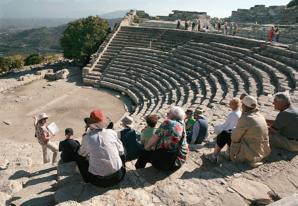 Sicily : Theater at Segesta, 3d century BC. Barbara Barletta lecturing to a tour group seated in the theater, carved from living rock of the hillside.