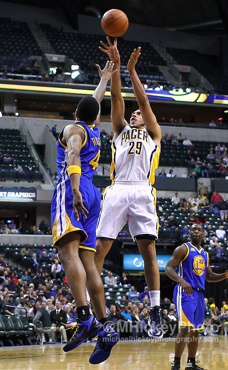 Feb. 28, 2012; Indianapolis, IN, USA; Indiana Pacers forward Jeff Pendergraph (29) shoots the ball against Golden State Warriors shooting guard Brandon Rush (4) at Bankers Life Fieldhouse. Indiana defeated Golden State 102-78. Mandatory credit: Michael Hickey-US PRESSWIRE