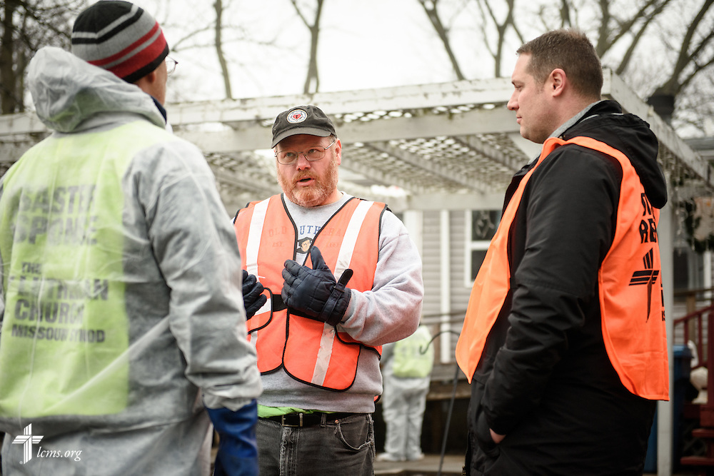 The Rev. Donald Love, pastor at Calvary Lutheran Church in Watseka, Ill., talks to Brent Amidon of Mount Pulaski, Ill., (left), and the Rev. Michael Meyer, manager of LCMS Disaster Response, during a volunteer event for cleanup of flood-damaged homes on Saturday, Jan. 9, 2016, in Watseka. LCMS Communications/Erik M. Lunsford