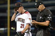 PHOENIX, AZ - JUNE 26:  Zack Greinke #21 of the Arizona Diamondbacks talks with home plate umpire Gabe Morales #47 after the first inning of the game against the Philadelphia Phillies at Chase Field on June 26, 2017 in Phoenix, Arizona.  (Photo by Jennifer Stewart/Getty Images)