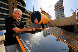 INDIA MUMBAI 30MAY10 - Brothers Amin and Mustafa Gilani present their solar thermal water heating installation on the roof of their apartment block in Juhu District, Mumbai, India...jre/Photo by Jiri Rezac..© Jiri Rezac 2010