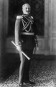 Wilhelm II (1859-1941) German Emperor (Kaiser) 1888-1918. Three-quarter length portrait standing in military uniform  facing front, holding a Field Marshal's baton.