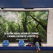 France, Paris December 2015 COP 21 UN Climate Conference. Poster on the metro saying 'Nature doesn't need man, man needs nature'.