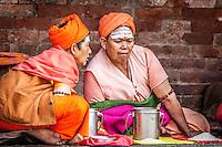 Women devoted to Shiva sit outside the Pashupatinath Temple, Kathmandu.
