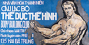 A billboard featuring a painting of Arnold Schwarzenegger, advertising a bodybuilding gym in downtown Ho Chi Minh City (Saigon), Vietnam.