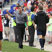 New York Red Bulls coach Mike Petke complains to the fourth official after a controversial first goal by Chicago Fire  during the New York Red Bulls Vs Chicago Fire, Major League Soccer regular season match at Red Bull Arena, Harrison, New Jersey. USA. 10th May 2014. Photo Tim Clayton