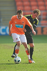 BLACKPOOL, ENGLAND - Wednesday, March 3, 2011: Liverpool's Steven Irwin and Blackpool's Luke Varney during the FA Premiership Reserves League (Northern Division) match at Bloomfield Road. (Photo by David Rawcliffe/Propaganda)
