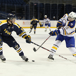 Buffalo, NY - Feb 20 : Ontario Junior Hockey League game action between the Buffalo Junior Sabres and the Whitby Fury, Jon O'Hara #15 of the Whitby Fury Hockey Club looks to block a shot by Ryan Kuhn #16 of the Buffalo Junior Sabres Hockey Club. (Photo By Timothy T. Ludwig / OHJL Images)