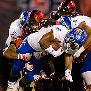 20 October 2018: San Diego State Aztecs linebacker Troy Cassidy (42) helps bring down San Jose State Spartans linebacker Tysyn Parker (28) in the first quarter. The Aztecs beat the Spartans 16-13 Saturday night at SDCCU Stadium.