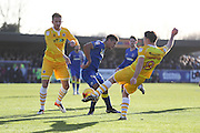 AFC Wimbledon striker Lyle Taylor (33) is surrounded by Millwall defender Byron Webster (17) and Millwall midfielder Ben Thompson (8) during the EFL Sky Bet League 1 match between AFC Wimbledon and Millwall at the Cherry Red Records Stadium, Kingston, England on 2 January 2017. Photo by Stuart Butcher.