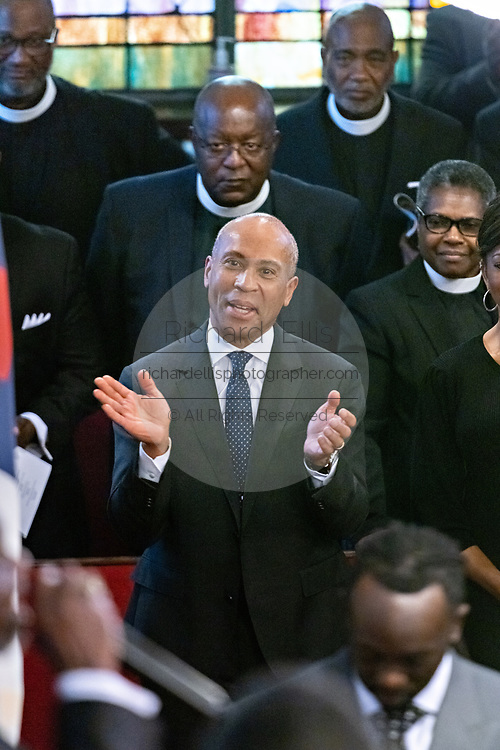 Democratic presidential hopeful Gov. Deval Patrick of Massachusetts, center, joins in the worship service at the historic Mother Emanuel AME Church January 1, 2020 in Charleston, South Carolina. The service celebrated Emancipation Day, marking the abolition of slavery in the United States.