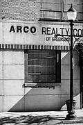 Elm Street storefront vignette captured in downtown Greensboro, North Carolina.