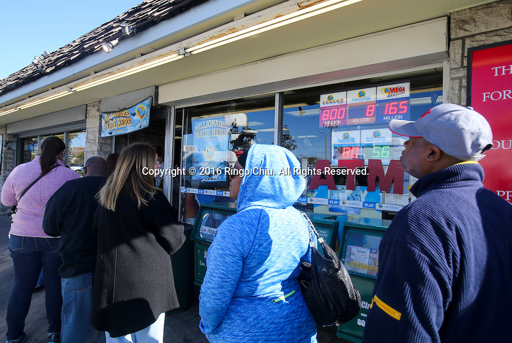 People line to buy Powerball lottery tickets at the Blue Bird Liquor store in Hawthorne, California on Friday, January 8, 2016. Lottery officials confirmed Friday that Saturday night&rsquo;s drawing will be for a record $800 million. The ever-increasing jackpot is a result of strong national sales ever since the jackpot was near $400 million just days ago. <br /> (Photo by Ringo Chiu/PHOTOFORMULA.com)<br /> <br /> Usage Notes: This content is intended for editorial use only. For other uses, additional clearances may be required.