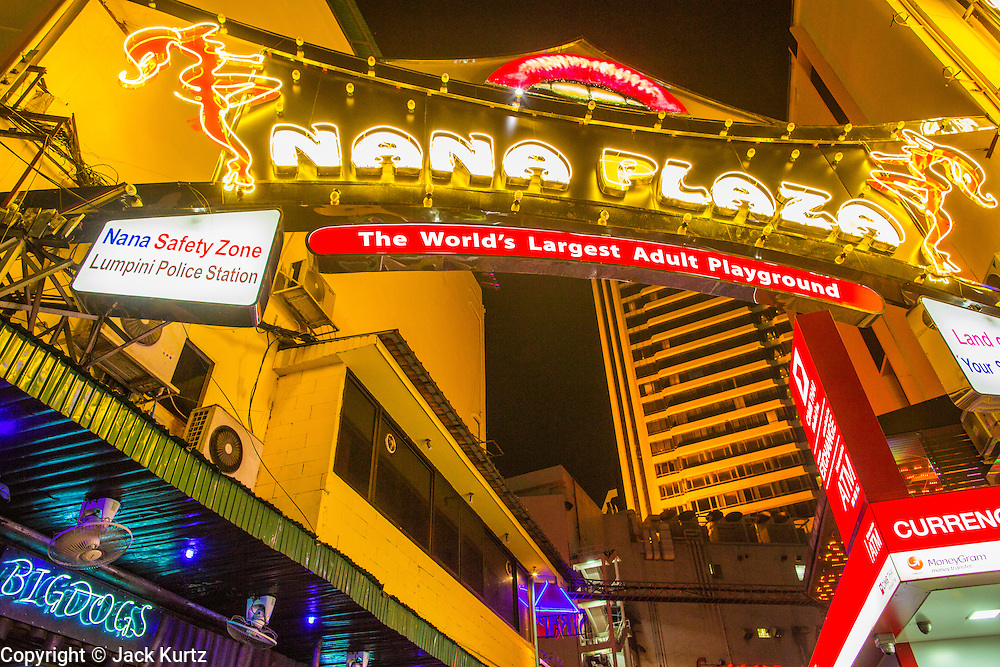 "12 JANUARY 2013 - BANGKOK, THAILAND:  The entrance to the Nana Entertainment Plaza on Sukhumvit Soi 4 in Bangkok. Prostitution in Thailand is illegal, although in practice it is tolerated and partly regulated. Prostitution is practiced openly throughout the country. The number of prostitutes is difficult to determine, estimates vary widely. Since the Vietnam War, Thailand has gained international notoriety among travelers from many countries as a sex tourism destination. One estimate published in 2003 placed the trade at US$ 4.3 billion per year or about three percent of the Thai economy. It has been suggested that at least 10% of tourist dollars may be spent on the sex trade. According to a 2001 report by the World Health Organisation: ""There are between 150,000 and 200,000 sex workers (in Thailand).""    PHOTO BY JACK KURTZ"