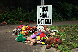 14 May 2014. New Orleans, Lousiana. <br /> The quiet corner tribute to  shooting victim Miqual Jackson on the corner of Josephine St and Brainard St in Central City where 14 year old Jackson was shot in the back of the head May 5th. Tragically he died shortly afterwards. His 15 year old brother  Lamichael was hit in the leg and survived. 52 year old Gregory Johnson is wanted on 1st degree murder charges. Randy Pittman, 49, an associate of Johnson's was arrested on 3 counts of being a principal to 1st degree murder. <br /> Charlie Varley/varleypix.com