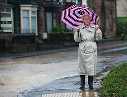 © Licensed to London News Pictures. 26/11/2012..Loftus, North Yorkshire, England..A woman looks on at flood water following another night of heavy rain which caused disruption in parts of East Cleveland and North Yorkshire with heavy floods in the small town of Loftus in North Yorkshire...Photo credit : Ian Forsyth/LNP