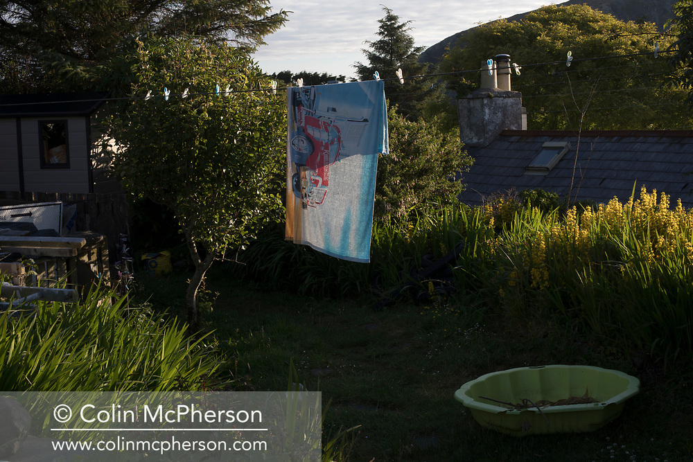 'Washing line, 2018' from Colin McPherson's project 'Treasured Island' part of the Document Scotland exhibition entitled 'A Contested Land' which will launch at the Martin Parr Foundation, Bristol, on 16th January, 2019. McPherson's work was made in 2018-2019 on Easdale, the smallest permanently inhabited Inner Hebridean island and looks at the historical legacy of the island, once world famous for its slate mining industry.<br /> <br /> Photograph © Colin McPherson, 2018 all rights reserved.