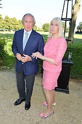 SIR JACKIE & LADY STEWART at the Frost Family Summer party in support of the British Heart Foundation and the Mile Frost Fund held at Burton Court, Chelsea, London  on 18th July 2016.