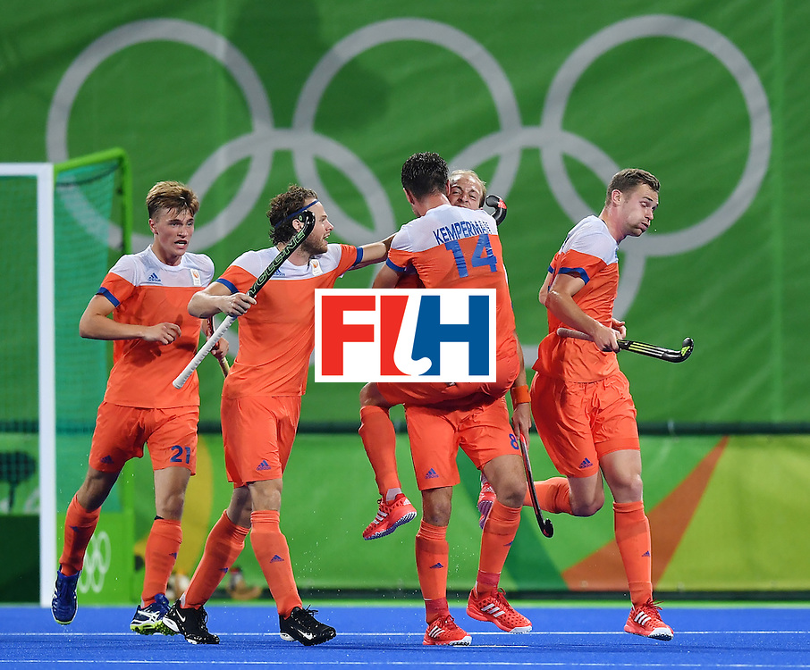 Netherland's players celebrate their second goal during the men's quarterfinal field hockey Netherlands vs Australia match of the Rio 2016 Olympics Games at the Olympic Hockey Centre in Rio de Janeiro on August 14, 2016. / AFP / MANAN VATSYAYANA        (Photo credit should read MANAN VATSYAYANA/AFP/Getty Images)