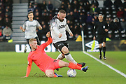 Derby County forward Wayne Rooney is tackled by Huddersfield Town midfielder Lewis O'Brien during the EFL Sky Bet Championship match between Derby County and Huddersfield Town at the Pride Park, Derby, England on 15 February 2020.