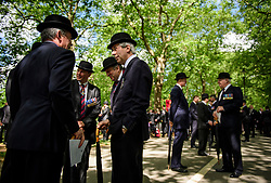 © London News Pictures. 14/05/2017. London, UK. A former cavalryman sits next to two members of the public while waiting for the parade to start. Thousands of serving and former Cavalrymen, many wearing bowler hats and carrying closed umbrellas, take part in Combined Cavalry Old Comrades Association Annual Parade in Hyde Park, London. A service of remembrance is held to honour Cavalry and other troops who have fallen in the service of their country since the first world war. Photo credit: Ben Cawthra/LNP