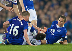 LIVERPOOL, ENGLAND - Saturday, March 12, 2016: Chelsea's captain John Terry gets a boot in the face from Everton's James McCarthy during the FA Cup Quarter-Final match at Goodison Park. (Pic by David Rawcliffe/Propaganda)