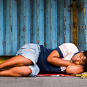 MANILA (Philippines). 2009. A homeless girl sleeping in the streets of Manila.