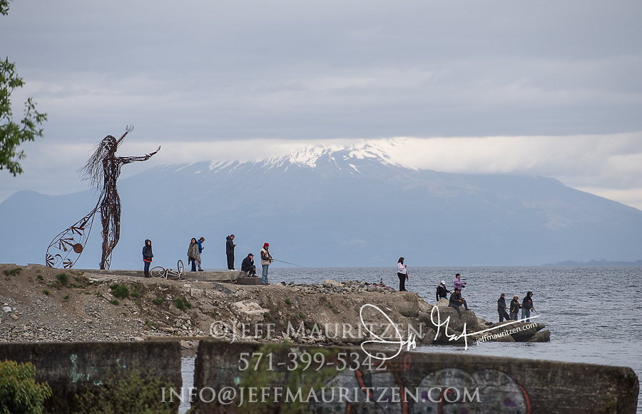 People fish along the shore of Lago Llanquihue in the Chile's Lake District.