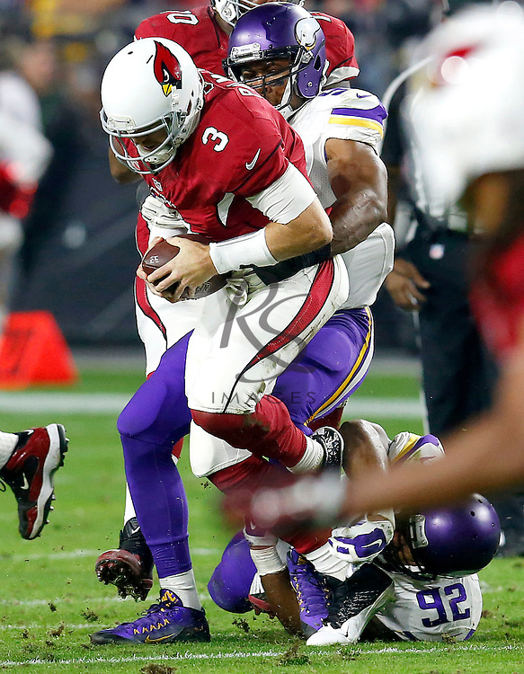 Arizona Cardinals quarterback Carson Palmer (3) is sacked by Minnesota Vikings defensive end Danielle Hunter during the first half of an NFL football game, Thursday, Dec. 10, 2015, in Glendale, Ariz. (AP Photo/Rick Scuteri)