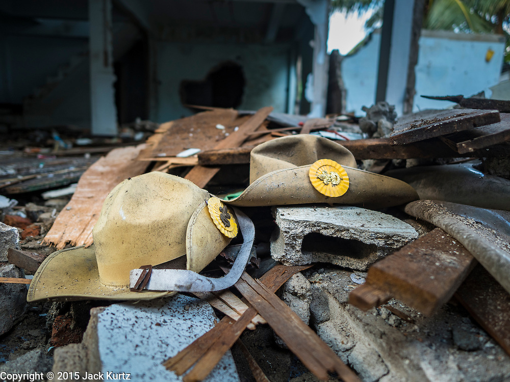 14 OCTOBER 2015 - BANGKOK, THAILAND: Thai Boy Scout hats, left behind in a destroyed home in the Wat Kalayanamit neighborhood. Fifty-four homes around Wat Kalayanamit, a historic Buddhist temple on the Chao Phraya River in the Thonburi section of Bangkok, are being razed and the residents evicted to make way for new development at the temple. The abbot of the temple said he was evicting the residents, who have lived on the temple grounds for generations, because their homes are unsafe and because he wants to improve the temple grounds. The evictions are a part of a Bangkok trend, especially along the Chao Phraya River and BTS light rail lines. Low income people are being evicted from their long time homes to make way for urban renewal.         PHOTO BY JACK KURTZ