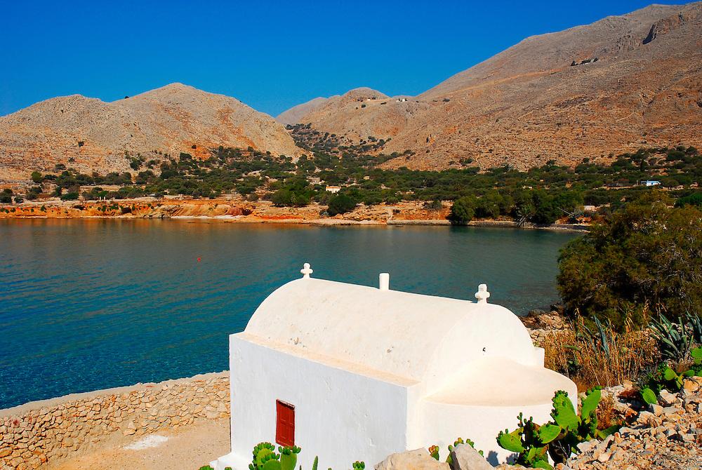 Pontamos, Halki. A church next to the sea. Dodecanese islands, Greece, Europe.