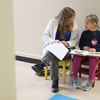 Lauren Wood | Buy at photos.djournal.com<br /> Volunteer Sherry Jenkins talks to second grader Alexis Lewis as she reads a book about Olivia the Pig aloud Thursday morning at Joyner Elementary School.