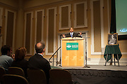 Ohio University President Roderick McDavis congratulates Dr. Christopher France on recieving the 2014 Distinguished Professor Award after unveiling his portrait in Baker University Center Ballroom on Tuesday, March 10.