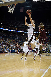 Southern Illinois Salukis guard Bryan Mullins (10) beats Virginia Tech Hokies Nigel Munson (3) to the basket.  The #4 seed Southern Illinois Salukis defeated the #5 seed Virginia Tech Hokies 63-48 in the second round of the Men's NCAA Basketball Tournament at the Nationwide Arena in Columbus, OH on March 18, 2007.
