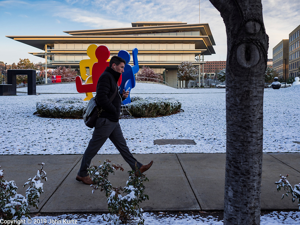 29 OCTOBER 2019 - DES MOINES, IOWA: A person walks past the fresh dusting of snow in the Poppajohn Sculpture Park in downtown Des Moines early Tuesday morning. An unseasonably early dusting of snow, less than 1 inch, blanketed the Des Moines area Tuesday morning. The snow did not accumulate on roads or sidewalks. Des Moines normally gets its first accumulation of snow in mid-November. More snow is expected later this week.              PHOTO BY JACK KURTZ