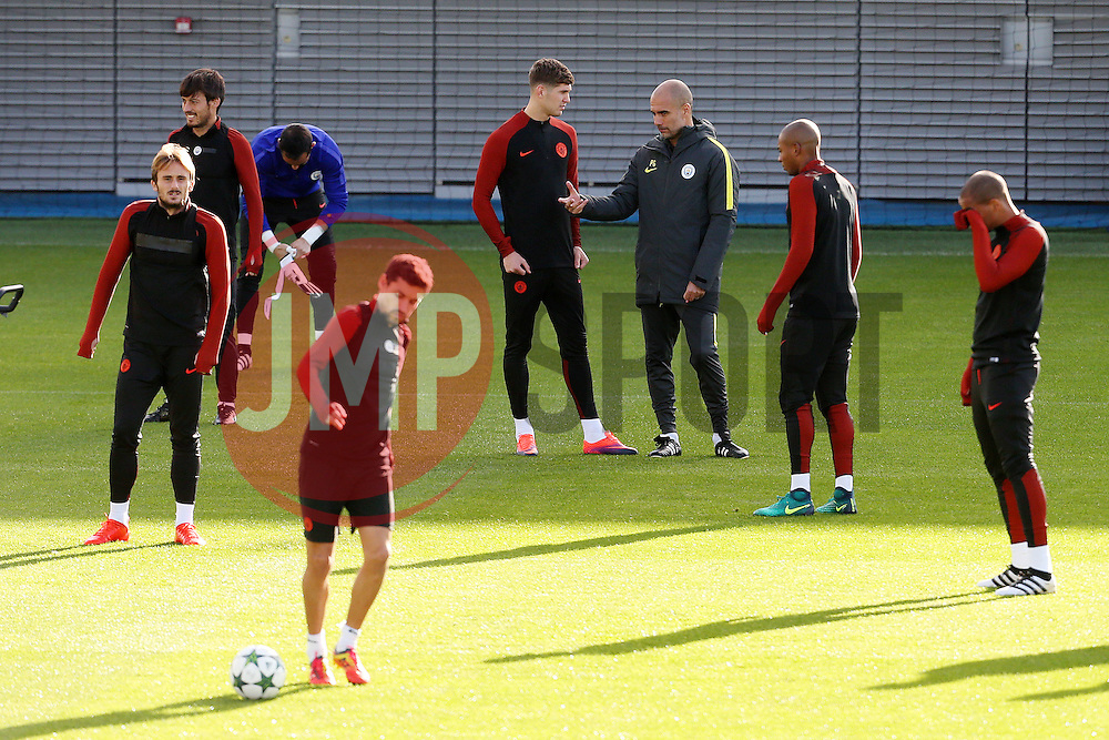 Manchester City manager Pep Guardiola talks with John Stones  - Mandatory by-line: Matt McNulty/JMP - 18/10/2016 - FOOTBALL - Manchester City - Training session ahead of Champions League qualifier against FC Barcelona