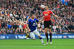 Michael Carrick of Manchester United controls the ball under pressure from Ross Barkley of Everton - Mandatory byline: Jason Brown/JMP - 07966386802 - 23/04/2016 - FOOTBALL - Wembley Stadium - London, England - Everton v Manchester United - The Emirates FA Cup