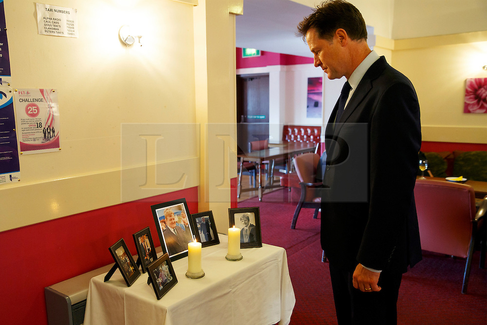 © Licensed to London News Pictures. 12/06/2015. Fort William, UK. Ex-Liberal Democrat leader Nick Clegg reflecting whilst looking at pictures of Charles Kennedy after the funeral of ex-Liberal Democrat leader at St John's Church in Caol, near his Fort William home in Scotland on Friday, June 12, 2015. Mr Kennedy died suddenly on June 1, 2015 at the age of 55 after suffering a major haemorrhage as a result of a long battle with alcoholism. Photo credit: Tolga Akmen/LNP