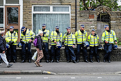 Metropolitan Police Officers wait for orders as anti-fascists gather to protest against a march held by the English Defence League. Walthamstow London May 2015