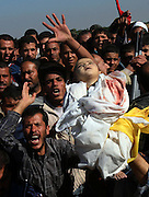 ".The body of  Palestinian  baby girl ,1, Majak Sameer  Al A'athamein killed from the IDF shelling attack is buried in a new cemetary specially dug for the victims killed in the attack  on the outskirt of Beit Hanoun ,  Gaza November 9, 2006.Tens of thousands of Palestinians marched through Gaza on Thursday November 9,2006 in funeral processions for  the 18 people killed by Israeli shelling on what one militant faction called ""a day of tragedy beyond imajination""."