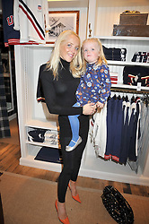 CLARE VAN DAM and her daughter AMBER at 'Paint Your Polo Celebration' a children's party in aid of the charity Clic Sargent held at Ralph Lauren, 139/141 Fulham Road, London on 28th April 2009.