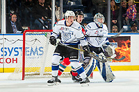 KELOWNA, CANADA - DECEMBER 7: Kyle Topping #24 of the Kelowna Rockets looks for the pass in front of the net of Griffen Outhouse #30 as Ralph Jarratt #4 of the Victoria Royals tries to block on December 7, 2018 at Prospera Place in Kelowna, British Columbia, Canada.  (Photo by Marissa Baecker/Shoot the Breeze)