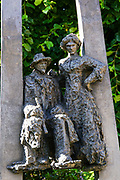 Statue of old fashioned couple in a park, Jurmala, Latvia
