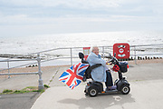 Sue Szlafke in front, Grand Parade of mobility scooters, Bexhill wheel and walk mobility carriages. Proceeds to Bexhill Caring Community. 16 September 2018