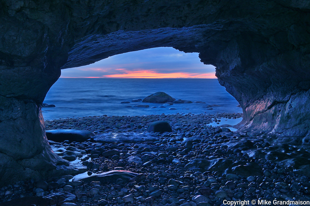 Sunset on Gulf of St. Lawrence and ancient limestone carved by eons of pounding surf <br /> The Arches Provincial Park<br /> Newfoundland & Labrador<br /> Canada